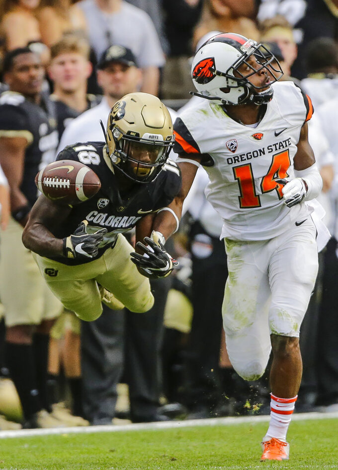 b76cc9b8e32 Colorado wide receiver Tony Brown (18) misses a catch against Oregon State  cornerback Kaleb Hayes (14) during the second half of an NCAA football  game
