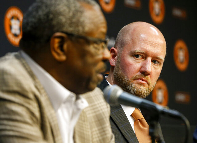 James Click, the newly-hired Houston Astros general manager, listens as Astros manager Dusty Baker speaks during a baseball press conference Tuesday, Feb. 4, 2020, at Minute Maid Park in Houston. (Jon Shapley/Houston Chronicle via AP)