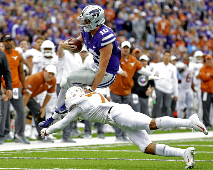 FILE - In this Sept. 29, 2018, file photo, Kansas State quarterback Skylar Thompson (10) is tackled by Texas' Caden Sterns (7) after scrambling for a first down in the fourth quarter of a college football game in Manhattan, Kan. Texas coach Tom Herman said Monday, Sept. 23, 2019, the Longhorns have lost two more starters in the defensive secondary for several weeks after getting hurt in a conference-opening win over Oklahoma State. All-Big 12 safety Sterns, the team's leading tackler, is expected to miss the next four weeks with a knee ligament sprain and cornerback Jalen Green is expected to miss at least that much time with a dislocated shoulder. (AP Photo/Colin E. Braley, File)