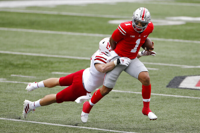 Nebraska linebacker Will Honas, left, tackles Ohio State quarterback Justin Fields during the first half of an NCAA college football game Saturday, Oct. 24, 2020, in Columbus, Ohio. (AP Photo/Jay LaPrete)