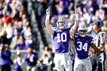 Kansas State quarterback Skylar Thompson (10) and running back James Gilbert (34) celebrate Thompson's touchdown against Oklahoma during NCAA football game at Bill Snyder Family Stadium in Manhattan, Kan., Saturday, Oct. 26, 2019. (Ian Maule/Tulsa World via AP)