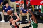 Miami Heat guard Tyler Herro (14) takes a shot as Boston Celtics' Marcus Smart, right, defends during the first half of Game 4 of an NBA basketball Eastern Conference final, Wednesday, Sept. 23, 2020, in Lake Buena Vista, Fla. (AP Photo/Mark J. Terrill)
