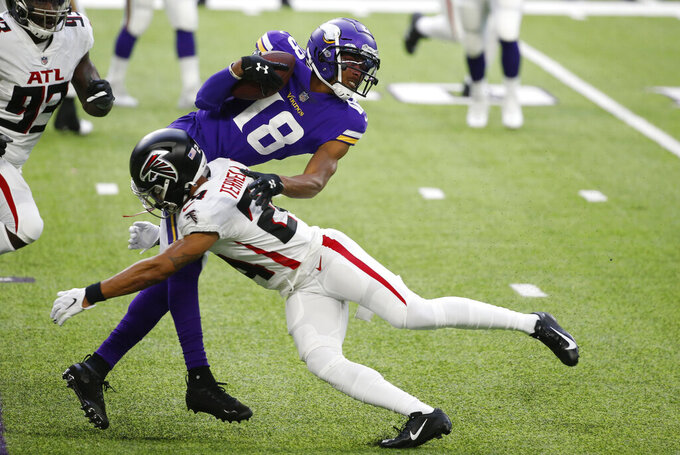 Minnesota Vikings wide receiver Justin Jefferson (18) is tackled by Atlanta Falcons cornerback A.J. Terrell during the first half of an NFL football game, Sunday, Oct. 18, 2020, in Minneapolis. (AP Photo/Bruce Kluckhohn)