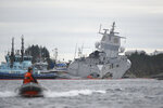The Norwegian frigate KNM Helge Ingstad, right, after a collision with the tanker Sola TS, in Oygarden, Norway, Thursday Nov. 8, 2018. Norway's military says the 127-man crew on a Navy frigate has been evacuated after the ship was rammed by a Malta-flagged tanker while docked in a Norwegian harbor. Seven people were slightly injured. (Marit Hommedal/NTB Scanpix via AP)