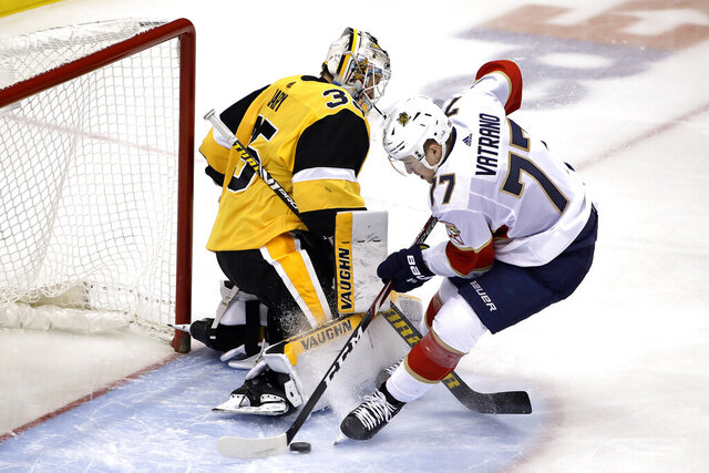 Florida Panthers' Frank Vatrano (77) puts a rebound behind Pittsburgh Penguins goaltender Tristan Jarry (35) for a goal during the first period of an NHL hockey game in Pittsburgh, Sunday, Jan. 5, 2020. (AP Photo/Gene J. Puskar)