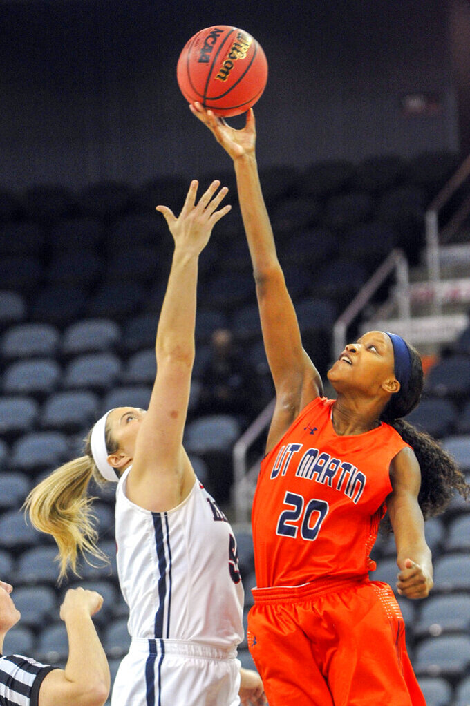 UT Martin's Chelsey Perry (20) take control of the opening tipoff from Belmont's Maddie Wright (55) during the first half of an NCAA college basketball game in the championship of the Ohio Valley Conference basketball tournament, Saturday, March 9, 2019, in Evansville, Ind. (AP Photo/Daniel R. Patmore)