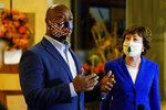 Sen. Tim Scott, R-S.C., left, speaks at a news conference with Sen. Susan Collins, R-Maine, right, in Waterville, Maine, Friday, Oct. 2, 2020. Scott accompanied Collins, who is seeking re-election, as she visited businesses on a campaign swing through downtown Waterville. (AP Photo/Robert F. Bukaty)