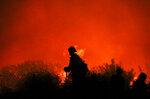 Firefighters battle the Saddleridge fire in Sylmar, Calif., Friday Oct. 11, 2019. (AP Photo/David Swanson)
