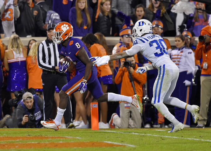 Clemson's Justyn Ross (8) runs in for a touchdown while defended by Duke's Brandon Feamster during the first half of an NCAA college football game Saturday, Nov. 17, 2018, in Clemson, S.C. (AP Photo/Richard Shiro)