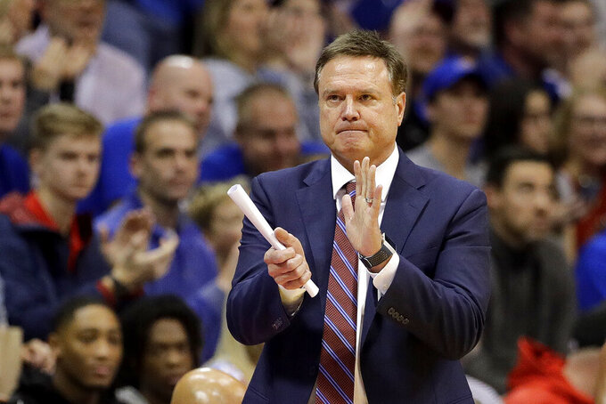Kansas coach Bill Self talks to his players during the second half of the team's NCAA college basketball game against UNC Greensboro on Friday, Nov. 8, 2019, in Lawrence, Kan. Kansas won 74-62. (AP Photo/Charlie Riedel)