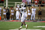 Florida International's D'vonte Price (24) catches a pass during the second half of an NCAA college football game against Texas Tech, Saturday, Sept. 18, 2021, in Lubbock, Texas. (AP Photo/Brad Tollefson)