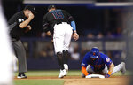 Miami Marlins shortstop Miguel Rojas (19) tags out New York Mets' Jeff McNeil (6) during the seventh inning of a baseball game on Saturday, July 13, 2019, in Miami. (AP Photo/Brynn Anderson)