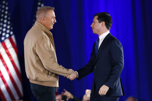 Democratic presidential candidate South Bend, Ind., Mayor Pete Buttigieg greets actor Kevin Costner, left, during a campaign event, Sunday, Dec. 22, 2019, in Indianola, Iowa. Costner endorsed Buttigieg's candidacy at the event. (AP Photo/Charlie Neibergall)