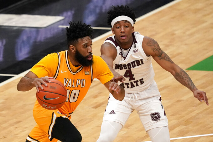 Valparaiso's Eron Gordon (10) drives past Missouri State's Ja'Monta Black (4) during the second half of an NCAA college basketball game in the quarterfinal round of the Missouri Valley Conference men's tournament Friday, March 5, 2021, in St. Louis. (AP Photo/Jeff Roberson)