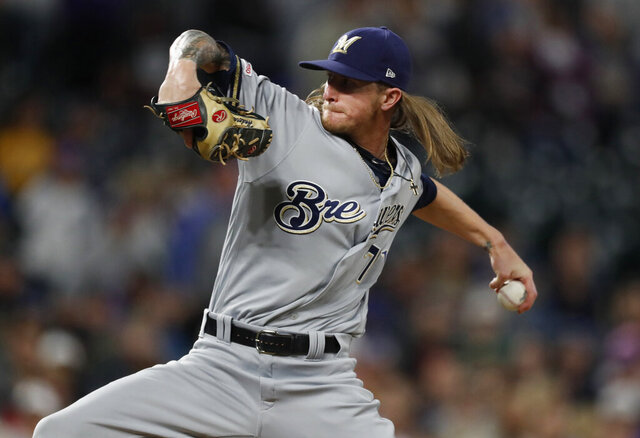 FILE - In this Saturday, Sept. 28, 2019 file photo,Milwaukee Brewers relief pitcher Josh Hader (71) in the ninth inning of a baseball game in Denver. All-Star closer Josh Hader went to a hearing with Milwaukee on Thursday, Feb. 13, 2020 after just making the eligibility cutoff with 2 years, 115 days of major league service. Hader asked for a raise from $687,600 to $6.4 million, and the Brewers argued for $4.1 million. (AP Photo/David Zalubowski, File)