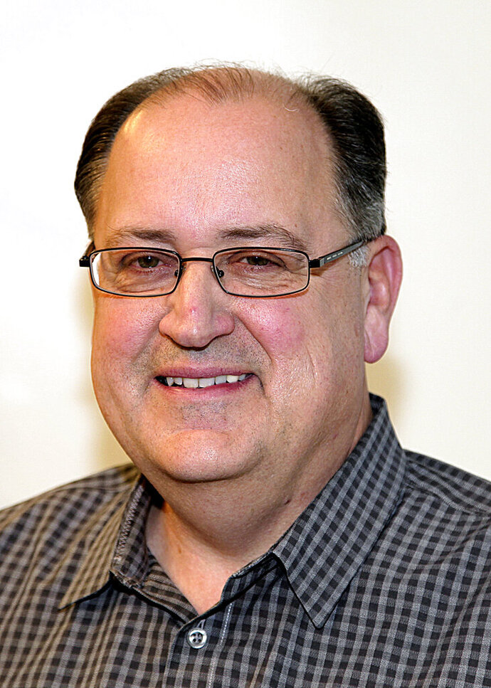 Nick Cafardo, former Boston Globe sports columnist, poses in this undated photo. Longtime Boston Globe baseball writer  has died after collapsing at the Red Sox's spring training ballpark. He was 62. The newspaper said Cafardo had an embolism Thursday, Feb. 21, 2019, and Red Sox medical staff was unable to revive him. (John Ioven/The Boston Globe via AP)
