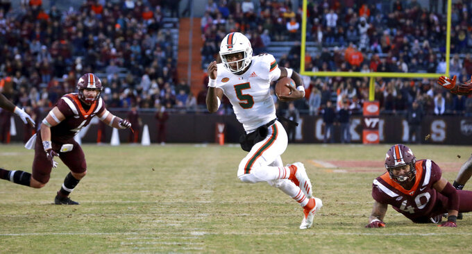 Miami quarterback N'Kosi Perry (5) runs down to the 1 yard line in the first half of an NCAA college football game against Virginia Tech in Blacksburg, Va., Saturday, Nov. 17 2018. (Matt Gentry/The Roanoke Times via AP)