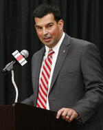 Ohio State NCAA college football offensive coordinator Ryan Day answers questions during a news conference announcing his hiring as head coach after Urban Meyer announced his retirement Tuesday, Dec. 4, 2018, in Columbus, Ohio. (AP Photo/Jay LaPrete)