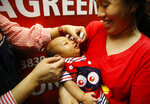 A baby gets an oral anti-polio vaccine during the launch of a campaign to end the resurgence of polio after health authorities confirmed a polio case in the country Friday, Sept. 20, 2019 at suburban Quezon city northeast of Manila, Philippines. Philippine health officials declared a polio outbreak in the country on Thursday, nearly two decades after the World Health Organization declared it to be free of the highly contagious and potentially deadly disease. (AP Photo/Bullit Marquez)
