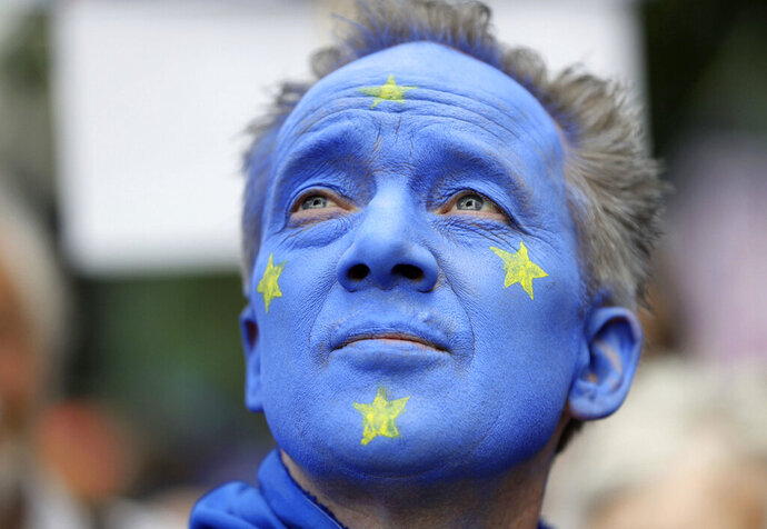 A Pro-European Union supporter with his face painted in the colours of the European Union Flag, takes part in the March for Change, in London, Saturday July 20, 2019. (Aaron Chown/PA via AP)