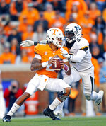 Tennessee quarterback Jarrett Guarantano (2) is sacked by Missouri safety Tyree Gillespie (9) in the first half of an NCAA college football game Saturday, Nov. 17, 2018, in Knoxville, Tenn. (AP Photo/Wade Payne)