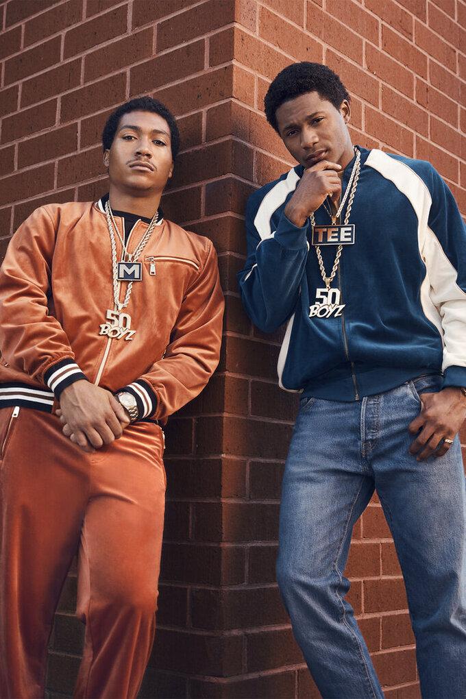 "This image released by Starz shows Demetrius ""Lil Meech"" Flenory Jr., left and Da'Vinchi from the series ""BMF"" (Black Mafia Family), premiering Sunday on Starz. (Gari Askew/Starz via AP)"