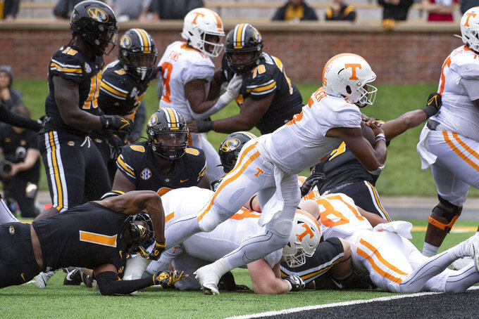 Tennessee quarterback Hendon Hooker, right, scores a touchdown during the second quarter of an NCAA college football game against Missouri Saturday, Oct. 2, 2021, in Columbia, Mo. (AP Photo/L.G. Patterson)