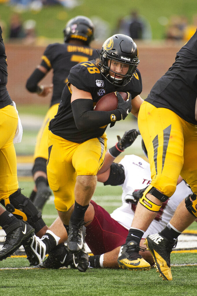 Missouri running back Dawson Downing runs the ball during the second quarter of an NCAA college football game against Troy Saturday, Oct. 5, 2019, in Columbia, Mo. Missouri won the game 42-10. (AP Photo/L.G. Patterson)