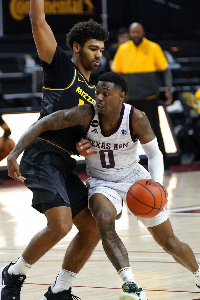 Texas A&M guard Jay Jay Chandler (0) drives the lane against Missouri guard Mark Smith (13) during the second half of an NCAA college basketball game Saturday, Jan. 16, 2021, in College Station, Texas. (AP Photo/Sam Craft)