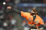 San Francisco Giants pitcher Johnny Cueto works against the Los Angeles Dodgers during the first inning of a baseball game Friday, Sept. 27, 2019, in San Francisco. (AP Photo/Tony Avelar)