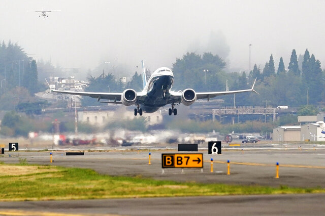 A Boeing 737 MAX jet, piloted by Federal Aviation Administration (FAA) chief Steve Dickson, takes off on a test flight from Boeing Field, Wednesday, Sept. 30, 2020, in Seattle. The MAX was grounded worldwide in early March 2019 after the second of two fatal accidents that together killed 346 people aboard almost-new aircraft. (AP Photo/Elaine Thompson)