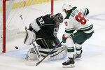 Minnesota Wild left wing Kirill Kaprizov, right, scores against Los Angeles Kings goaltender Jonathan Quick during overtime in an NHL hockey game in Los Angeles, Thursday, Jan. 14, 2021. (AP Photo/Alex Gallardo)