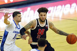 Nebraska's Teddy Allen (0) is defended by Creighton's Marcus Zegarowski (11) and Christian Bishop during the first half of an NCAA college basketball game in Omaha, Neb., Friday, Dec. 11, 2020. (AP Photo/Nati Harnik)