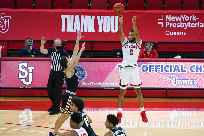 St. John's Julian Champagnie (2) shoots a 3-pointer over Villanova's Collin Gillespie (2) during the second half of an NCAA college basketball game Wednesday, Feb. 3, 2021, in New York. (AP Photo/Frank Franklin II)