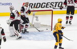 Nashville Predators' Matt Duchene (95) skates to teammates after they scored on Arizona Coyotes goalie Darcy Kuemper (35) as Niklas Hjalmarsson (4) digs the puck out of the net during first period NHL qualifying round game action in Edmonton, on Sunday, Aug. 2, 2020. (Jason Franson/The Canadian Press via AP)