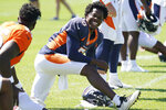 Denver Broncos quarterback Teddy Bridgewater (5) jokes with his teammates while stretching during a joint NFL football practice with the Minnesota Vikings on Wednesday, Aug. 11, 2021, in Eagan, Minn. (Anthony Souffle/Star Tribune via AP)