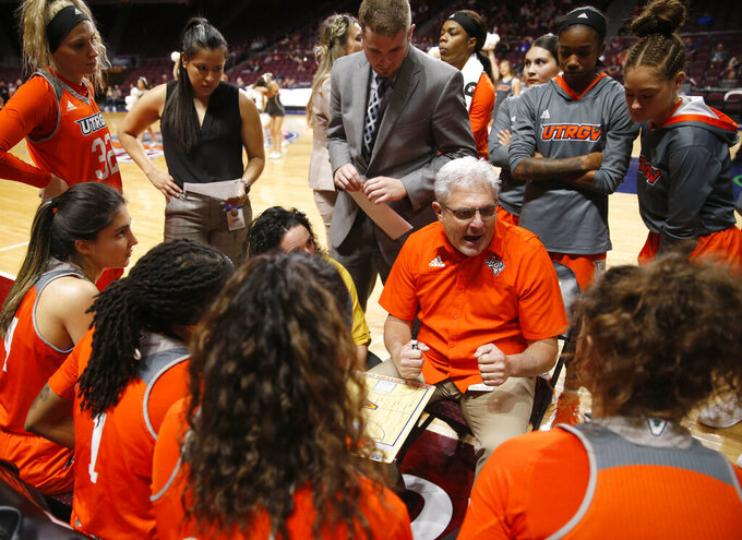 Texas-Rio Grande Valley head coach Lane Lord speaks with players during a time out against New Mexico State during a NCAA college basketball Western Athletic Conference Women's Tournament championship game Saturday, March 16, 2019, in Las Vegas. (AP Photo/Steve Marcus)