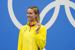 Emma Mckeon, of Australia, poses after winning the gold medal in the women's 100-meter freestyle final at the 2020 Summer Olympics, Friday, July 30, 2021, in Tokyo, Japan. (AP Photo/Jae C. Hong)