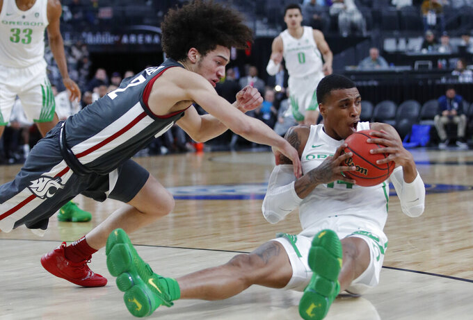 Oregon's Kenny Wooten, right, and Washington State's CJ Elleby scramble for the ball during the second half of an NCAA college basketball game in the first round of the Pac-12 men's tournament Wednesday, March 13, 2019, in Las Vegas. (AP Photo/John Locher)