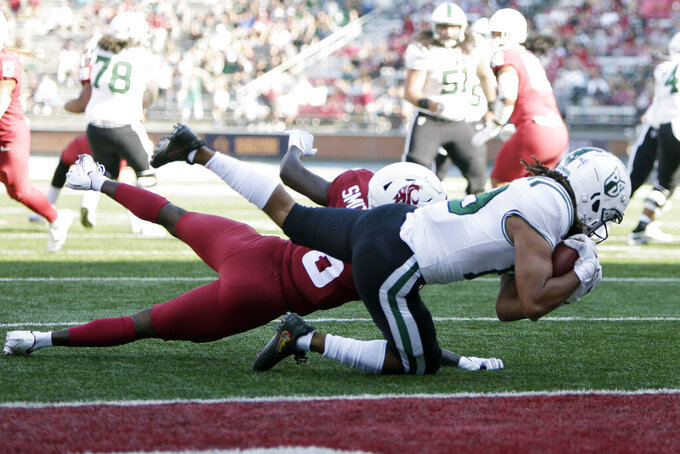 Portland State wide receiver Darien Chase, right, catches a pass while pressured by Washington State defensive back Chau Smith-Wade during the first half of an NCAA college football game, Saturday, Sept. 11, 2021, in Pullman, Wash. (AP Photo/Young Kwak)