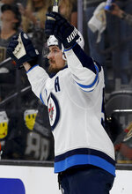 Winnipeg Jets center Mark Scheifele celebrates after scoring against the Vegas Golden Knights during the third period of Game 3 of the NHL hockey playoffs Western Conference finals, Wednesday, May 16, 2018, in Las Vegas. (AP Photo/John Locher)
