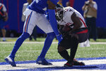 Atlanta Falcons wide receiver Olamide Zaccheaus, right, catches a touchdown pass during the first half of an NFL football game against the New York Giants, Sunday, Sept. 26, 2021, in East Rutherford, N.J. (AP Photo/Seth Wenig)