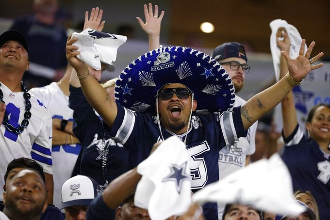 Dallas Cowboys fans cheer in the first half of an NFL football game against the Philadelphia Eagles in Arlington, Texas, Monday, Sept. 27, 2021. (AP Photo/Ron Jenkins)
