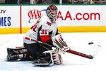 Ottawa Senators goaltender Anders Nilsson (31) blocks a shot during the first period of an NHL hockey game against the Dallas Stars in Dallas, Monday, Oct. 21, 2019. (AP Photo/Sam Hodde)