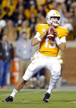 Tennessee quarterback Keller Chryst (19) drops back to pass in the second half of an NCAA college football game against Missouri Saturday, Nov. 17, 2018, in Knoxville, Tenn. (AP Photo/Wade Payne)