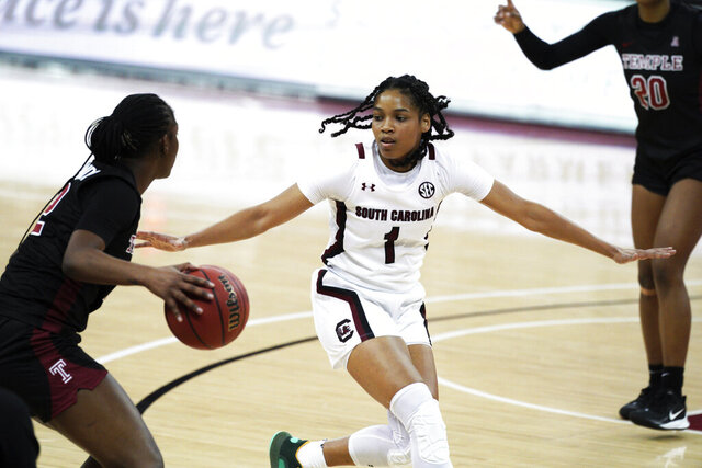 South Carolina guard Zia Cooke (1) defends Temple guard Asonah Alexander (2) during the second half of an NCAA college basketball game Thursday, Dec. 17, 2020, in Columbia, S.C. South Carolina won 103-41. (AP Photo/Sean Rayford)