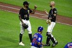 Chicago Cubs' Willson Contreras (40) heads off the field as Pittsburgh Pirates relief pitcher Felipe Vazquez (73) celebrates with catcher Jacob Stallings, right, after the team's 5-1 win in a baseball game in Pittsburgh, Tuesday, July 2, 2019. (AP Photo/Gene J. Puskar)
