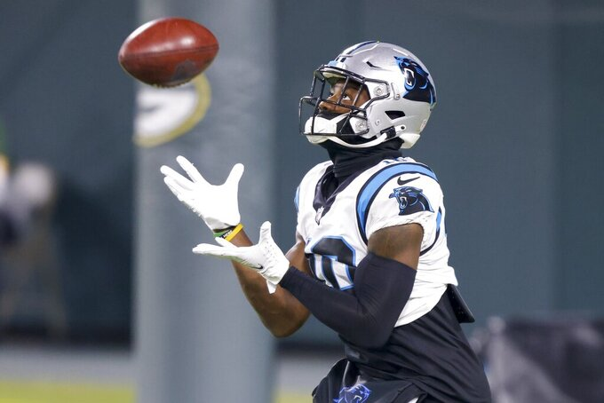 Carolina Panthers' Curtis Samuel warms up before an NFL football game against the Green Bay Packers Saturday, Dec. 19, 2020, in Green Bay, Wis. (AP Photo/Matt Ludtke)