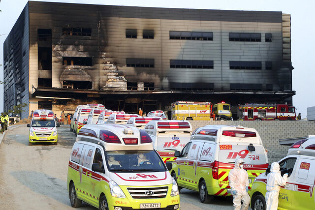 Emergency ambulances carrying victims leave a construction site after a fire in Icheon, South Korea, Wednesday, April 29, 2020. One of the South Korea's worst fires in years broke out at the construction site. (Hong Ki-won/Yonhap via AP)