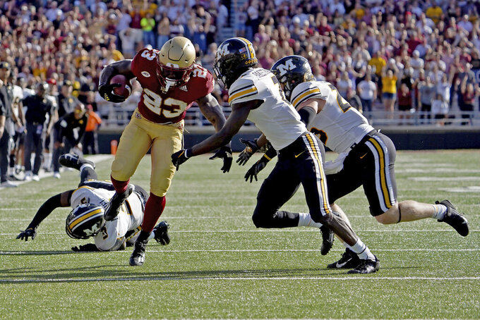 Boston College running back Travis Levy (23) rushes through the Missouri defense during the second half of an NCAA college football game, Saturday, Sept. 25, 2021, in Boston. (AP Photo/Mary Schwalm)